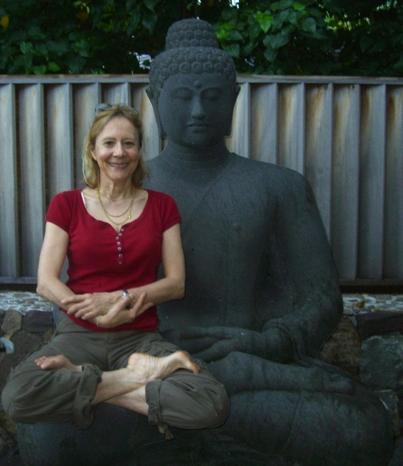 Esther Dyson posing with Buddha